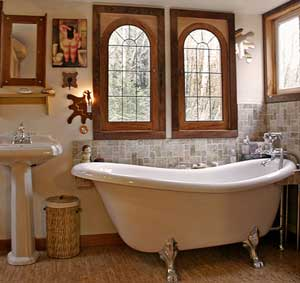 Soak in the tub with the windows open to the forest