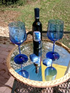Relax with a glass of wine at the Blue Owl Bed & Breakfast on Denman Island